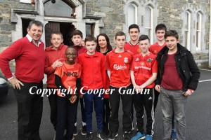 Students Evan Adetunji, Jake Doona, Mark Cooper, Adam Walsh, Filip Korzec, Krystian Wielgus, Dylan Doona, Paul O'Shea and Darragh O'Leary with teacher Mike Leahy and Mary Devane participating in the Wear Red in aid of Operation Resuscitation at St Brendan's College, Killarney on Friday. Photo by Michelle Cooper Galvin