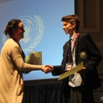 James Knoblauch accepting his award for best junior delegate