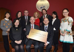 Sean Coffey Principal St Brendan's College Killarney receiving the Confucius Classroom in St Brendan's College plaque from Xia Yongbin UCC Confucius Institute with (front) n