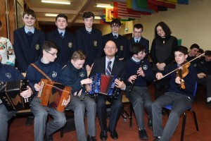 Xia Yongbin UCC Confucius Institute with students from St Brendan's College Killarney at the Confucius Classroom in St Brendan's College plaque presentation in the College.