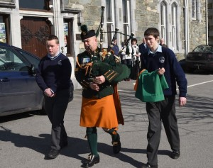 Sgt Noel McCarthy Collins Barracks with students Luke Moynihan and Daniel Keane preparing for the Flag Raising ceremony in St Brendan's College, Killarney. Photo by Michelle Cooper Galvin