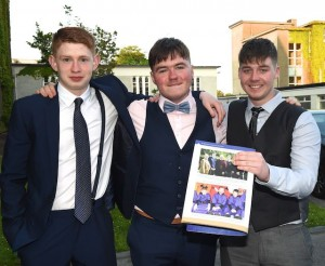 Can Griffin, Jack O'Connor and Craigh Courtney holding a photograph in the St Brenadns Yearbook 2016 which was taken in a Christmas play in their Loreto National School days at the Graduation Mass in St Brendan's College, Killarney on Tuesday. Photo by Michelle Cooper Galvin